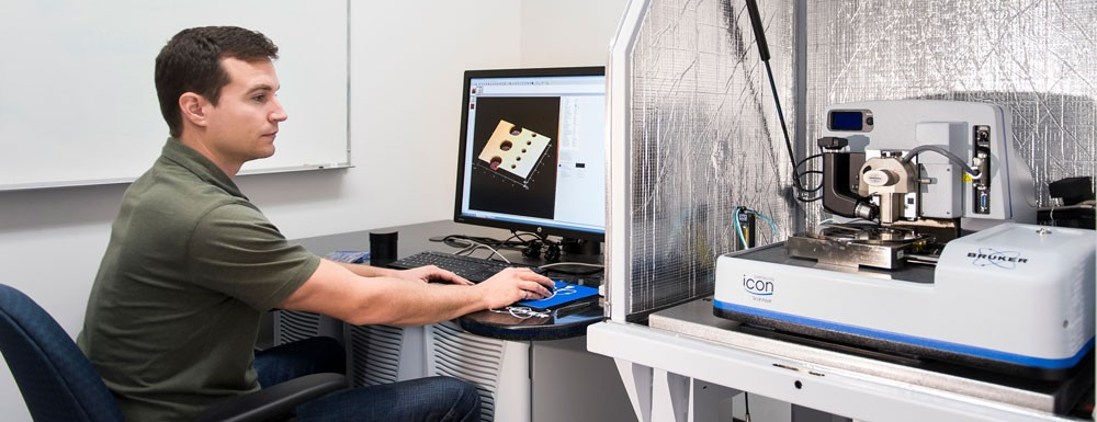 Person using structural analysis equipment at 4D LABS
